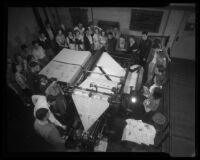 Students watching printing press at Los Angeles City College, Los Angeles, circa 1933-1938