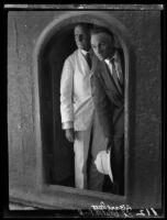 Adelbert Bartlett and Ed Blatchford looking through an arch, Jerusalem, 1925