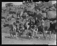 Young women on beach playing leapfrog, Pacific Palisades, 1928