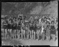 Young women on beach eating watermelon, Pacific Palisades, 1928
