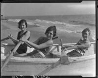 Young women posing in rowboat on beach, Pacific Palisades, 1927