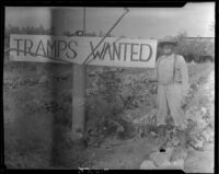 Man with Tramps Wanted sign, Visalia, 1920