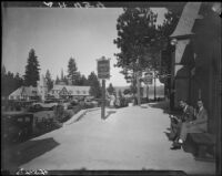 Two men seated on a bench in the village, Lake Arrowhead, 1929