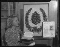 Santa Monica College student with wreath and article about poet Ina Donna Coolbrith, Santa Monica, 1934