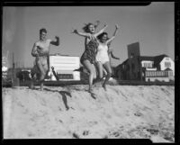 Young people jumping on beach, Santa Monica, 1938