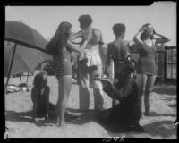 Young women preparing for sunbathing, Santa Monica, circa 1930