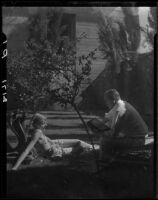 R. Lee Miller and Mrs. Jack Pfister in a patio, Palm Springs