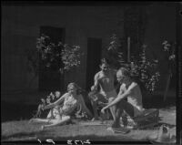 R. Lee Miller, Mrs. Jack Pfister and A. Boyd Mewborn in the sunny patio of Miller's home, Palm Springs