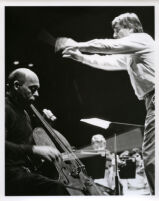 Janos Starker playing the cello in rehersal with an orchestra, 1986 [descriptive]