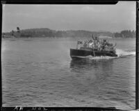 """Young people in motorboat """"Graceful"""" on lake, Lake Arrowhead, 1929"""