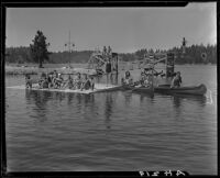 Young people in canoes, on floating dock, and on diving platforms, Lake Arrowhead, 1929
