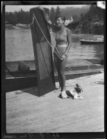 Young woman with aquaplaning board and dog, Lake Arrowhead, 1929