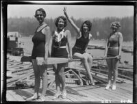 Young women with canoe paddles on dock, Lake Arrowhead, 1929