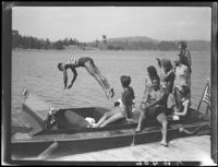 "Young man diving from motorboat ""Graceful,"" Lake Arrowhead, 1929"