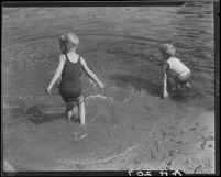 Children wading at edge of lake, Lake Arrowhead, 1929
