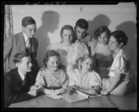 Young people at community dance, possibly signing guest book, Santa Monica, 1934