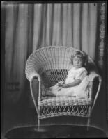 Carolyn Bartlett in wicker chair, Santa Monica, circa 1923