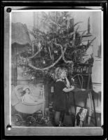 Carolyn Bartlett and Christmas tree, Santa Monica, circa 1925