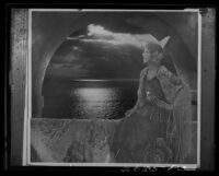 Montage photograph of young woman in arched window at sunset, [1920-1939?]