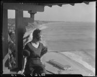 Woman overlooking ocean, Bernheimer Gardens, Pacific Palisades, 1927-1940