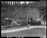 Woman on lake shore, Bernheimer Gardens, Pacific Palisades, 1927-1940