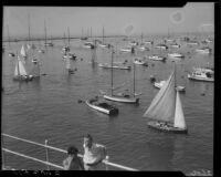 View of sailboats in the water behind the new breakwater during Regatta Week, Santa Monica, 1937