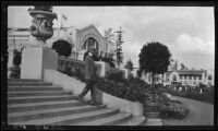 Man descending stairs near the Manufactures Building at the Alaska-Yukon-Pacific Exposition, Seattle, 1909