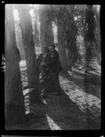 Adelbert Bartlett and another man among eucalyptus trees, Laguna Beach, 1925