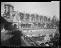Bird's-eye view of courtyard, building, and towers, Mission Inn, Riverside, 1932
