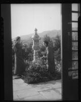 Women and pillar at Bernheimer Gardens, Pacific Palisades, 1927-1940
