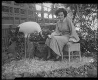 Woman with statue of crane, Bernheimer Gardens, Pacific Palisades, 1927-1940