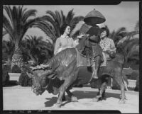 Women with statue of Tenjin reading on the back of an ox, Bernheimer Gardens, Pacific Palisades, 1927-1940