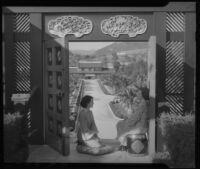 Women seated in doorway of Adolph L. Bernheimer residence, Bernheimer Garden, Pacific Palisades, 1927-1940
