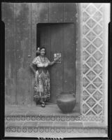 Woman in traditional Mexican dress in front of Hotel Playa de Ensenada, Ensenada, 1931