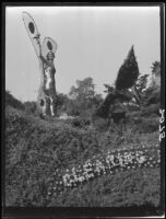 """The Last Rose of Summer"" float with a winged woodland elf in the Tournament of Roses Parade float, Pasadena, 1927"