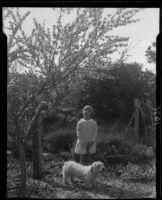 Adelaide Rearden posing next to a blossoming tree, Santa Monica, circa 1928