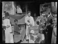 Street scene in the Near East? with Mazola oil posters, [1924?]