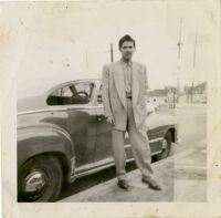 Arturo Guerra posing in front of someone else's car