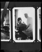 Dr. Leonard Siever, a dentist, with a patient at his dental office, Pasadena, 1917-1933
