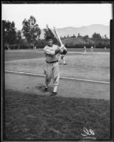 Al Simmons holding bats in a baseball field, 1930's