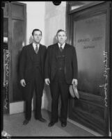 Meyer Simon and his son Norton Simon at the doorway to the Los Angeles County Grand Jury, Los Angeles, 1933