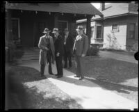Los Angeles police detective Joe Taylor and other law enforcement officials in front of home of kidnap victim Mary B. Skeele, 1933