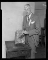 Mariposa County Judge W.A. Scott with section of tree grown around revolver, Los Angeles or Pasadena, 1931