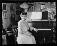 Soprano Marcella Sembrich at piano, 1930