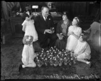 Los Angeles Mayor Frank Shaw with girls, woman, and Easter baskets, [Los Angeles?], 1933-1938