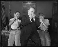 Los Angeles Mayor Frank Shaw and two young harmonica players, Los Angeles, 1935