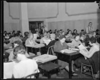 Women at desks with papers, [Los Angeles?], [1930-1938?]