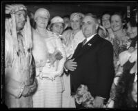 Los Angeles Mayor Frank Shaw, Mrs. Cora Shaw, group of women, and man in Indian dress, 1933-1938
