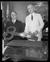 Los Angeles Mayor Frank Shaw presenting or receiving a key to the city, Los Angeles, 1933-1938