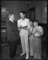 Los Angeles Mayor Frank Shaw, two young harmonica players, and harmonica teacher Kenneth Milton, Los Angeles, 1935